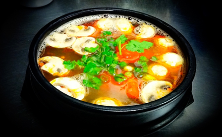 Bright orange color Tom Yam soup