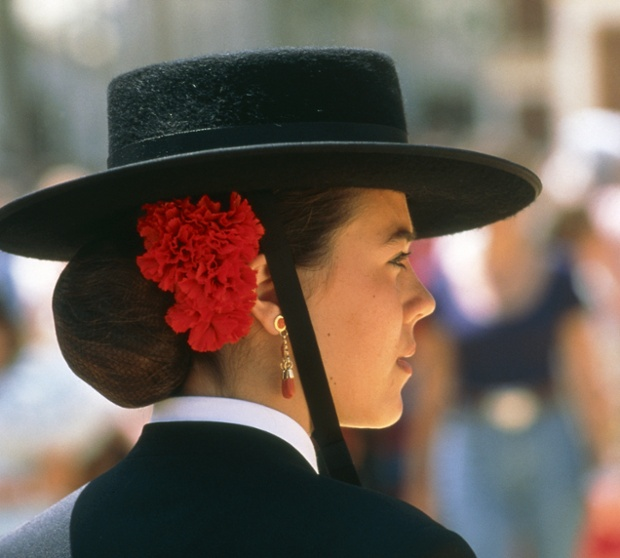 Young Spanish woman in Andalusian traditional clothes