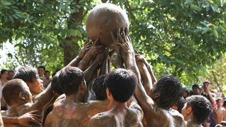 Vietnamese village holds traditional all-male mud wrestling competition