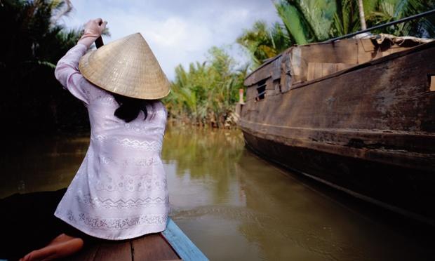 Girl Guiding Boat on Mekong Delta