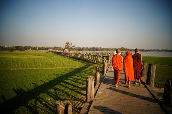 Monks and local residents walk across Ubein Bridge every afternoon.