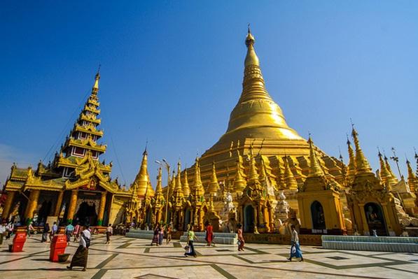 People walk around Shwedagon Pagoda in Yangon