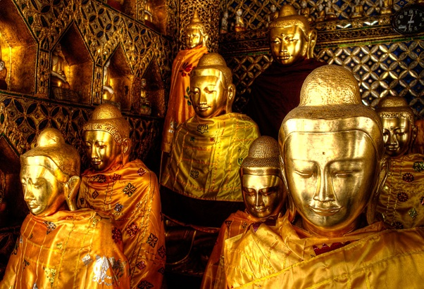 The golden statues of Buddha inside the Pagoda.