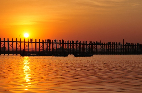The longest wooden bridge in the world is one of the most beautiful places for watching the sunset, voted by specializing travel site CNNGo.(CNN for Travel)