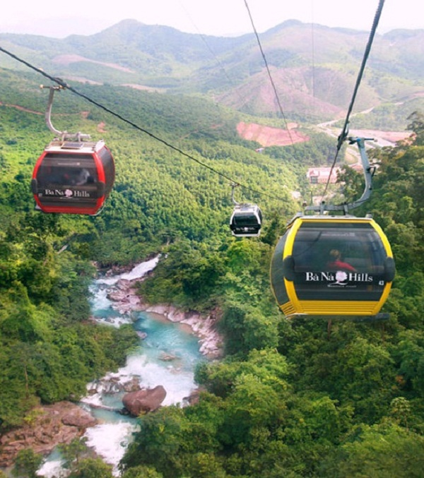 The visitors witnessing the magical forest and stunning mountains while sitting in the cable cars at the Ba Na