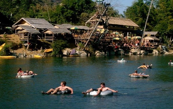 Tourists enjoying exciting activities in Vang Vieng