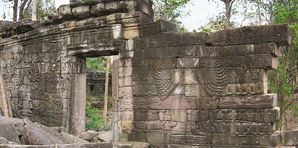 Avalokitesvara on the western gallery sculptured on the wall in the Bayon Temple