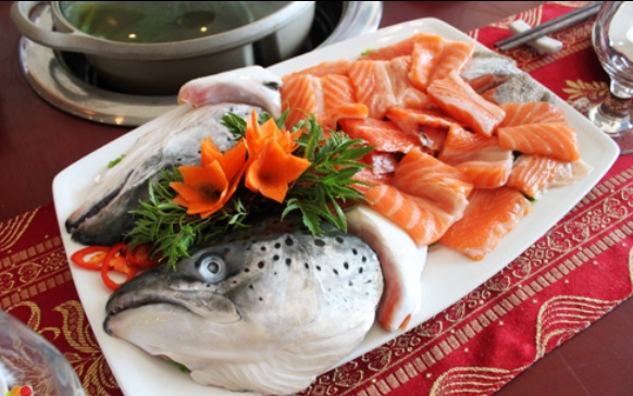 A steaming salmon hot pot is best enjoyed with a cup of Sapa special cider