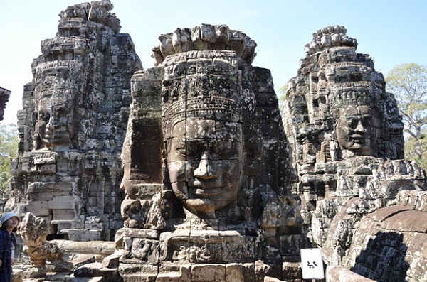 The Bayon temple features a sea of over 200 massive stone faces looking in all direction