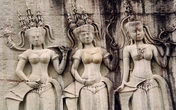 Carvings of Apsara dancers on the walls of Angkor's temples