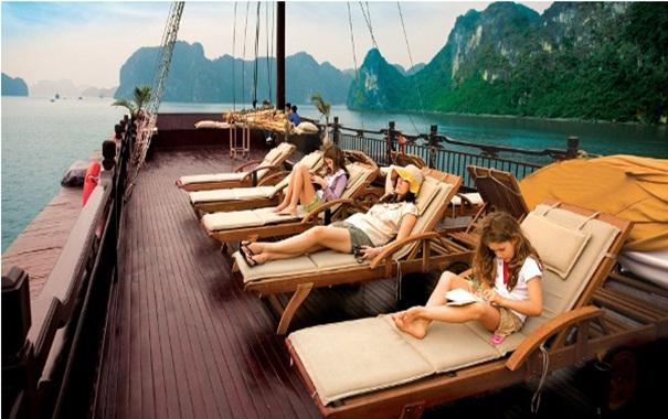 Travellers enjoying the sunset on luxury cruise