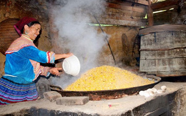 A Hmong woman is making traditional corn liquor