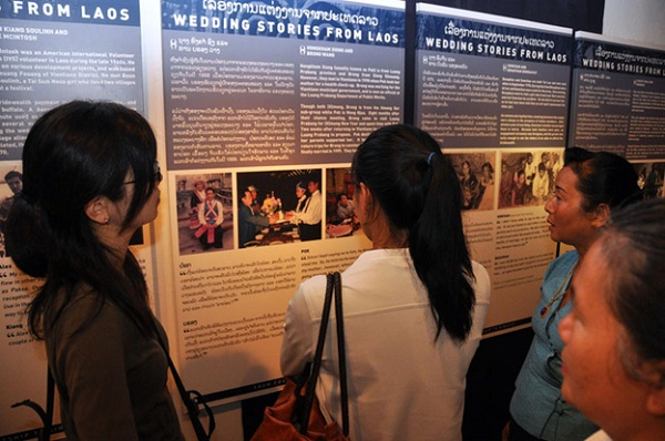 Lao visitors reading wedding stories as part of the new special exhibition