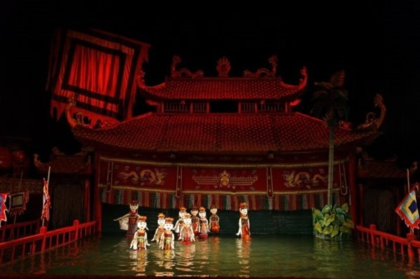 Travellers to the capital city of Hanoi are interested in water puppet show