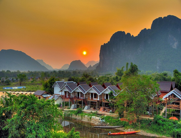 Vang Vieng looks like a rural scene from an Oriental silk painting