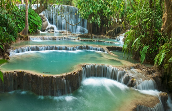 Kuang Si Waterfall is the biggest in the Luang Prabang area with three tiers leading to a 50-meter drop into spectacular azure pools before flowing downstream