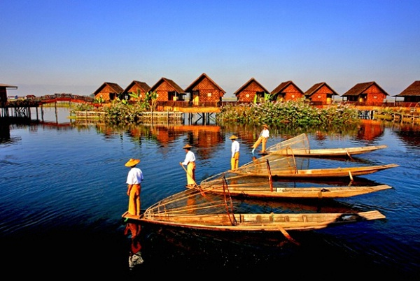 In villages and towns across the lake, wooden houses are built high on stilts