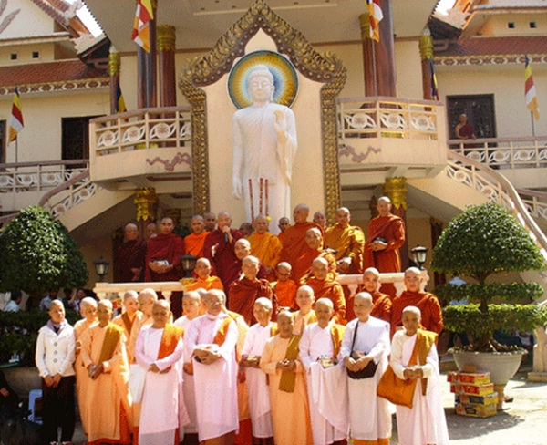 A lot of Buddhists and monks gather in Tam Bao pagoda