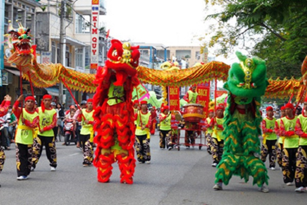 "A ""lion dance"" performance on the street to celebrate Tet"