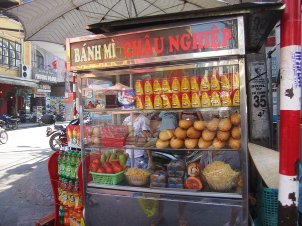 "A stall selling ""banh mi"" on the street in Vietnam"
