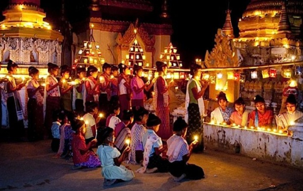 People lit candles during the festival