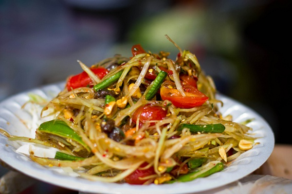 Papaya salad origins from Laos but then mixed into Thailand flavors