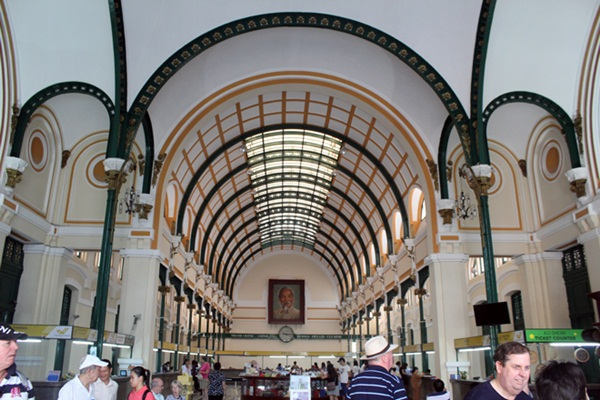 Saigon Central Post Office draws hundreds of tourists by its iconic colonial French details