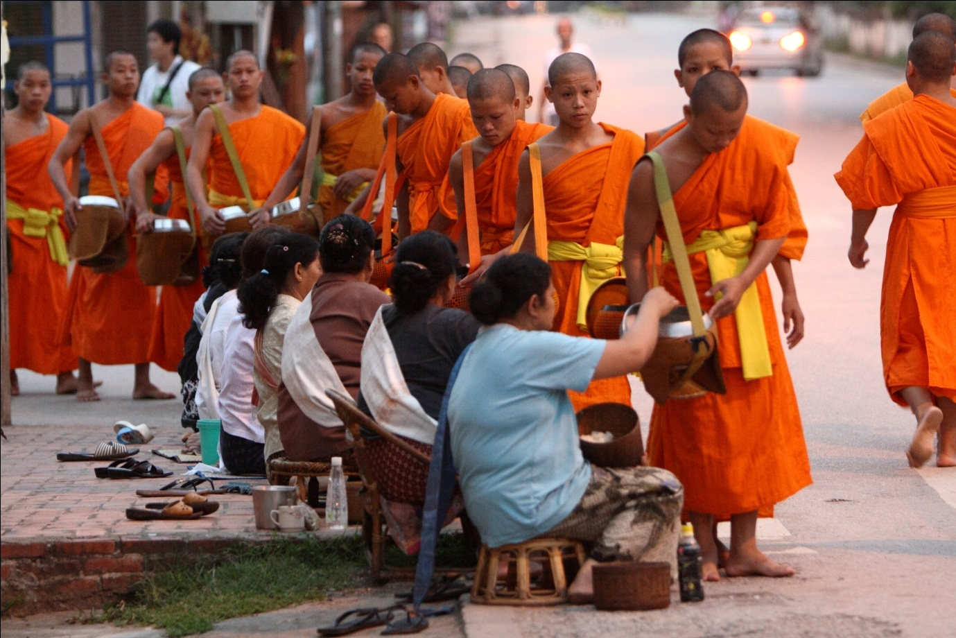 Monks collect alms at dawn in Luang Prabang