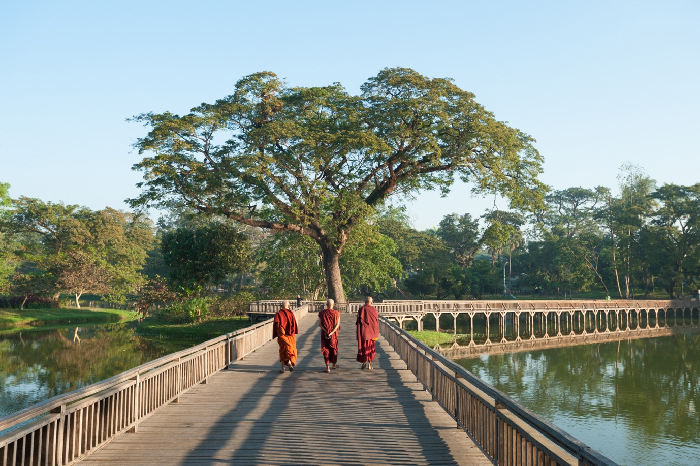 Monks walking along Kandawgyi lake