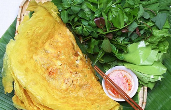 Banh Xeo is served with a lot of herbs