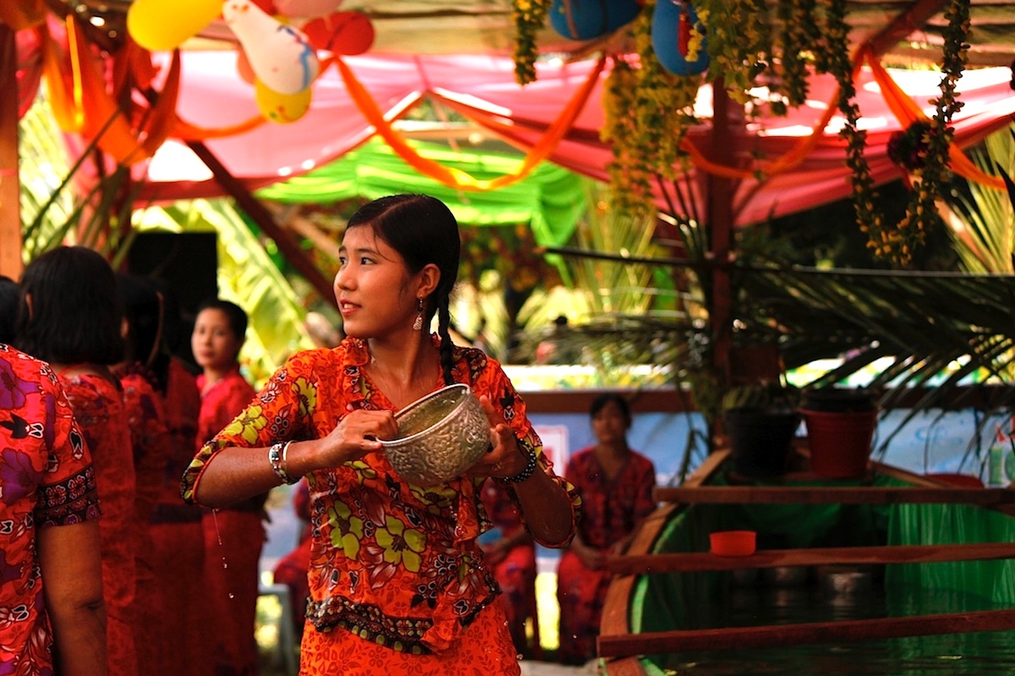 Burmese happily splash water at each other in the New Year occasion