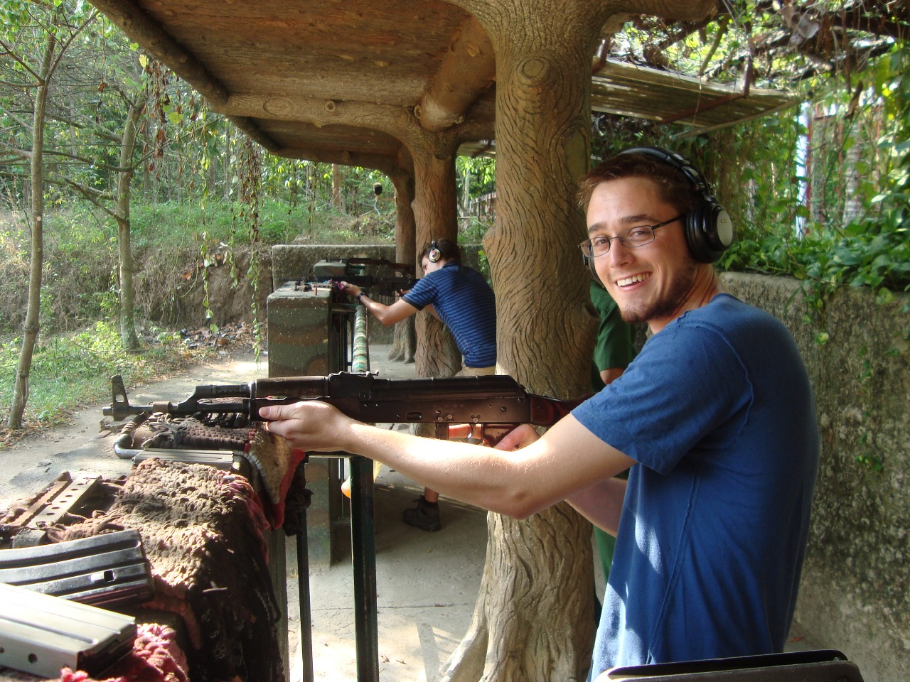 Tourists play paintball in Cu Chi