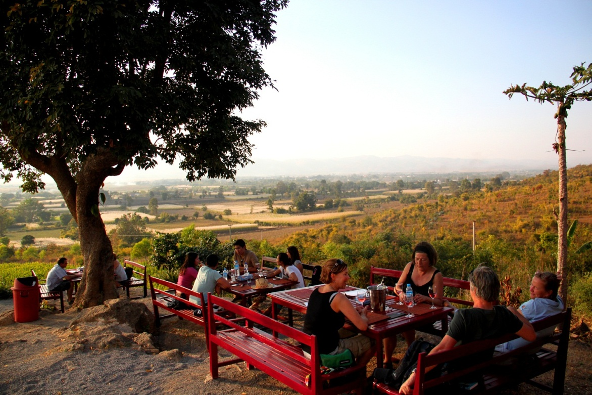 Sipping wine at the Red Mountain in Myanmar