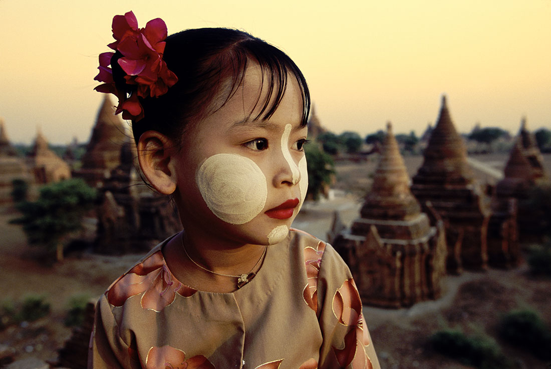 Thanaka on the cheek of litte Burmese girl