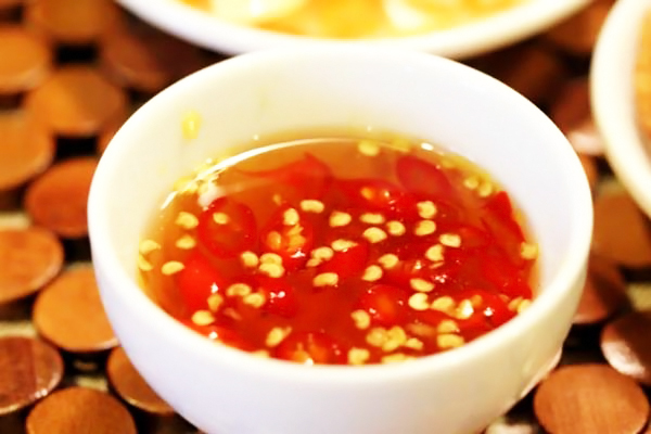 Enjoy 'Pho Cuon' with a sweet dipping sauce cup