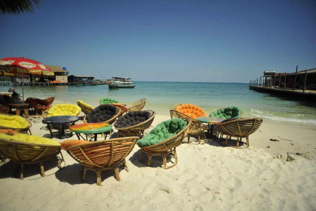 Cute chairs for tourists to relax and sunbathe among Koh rong beach