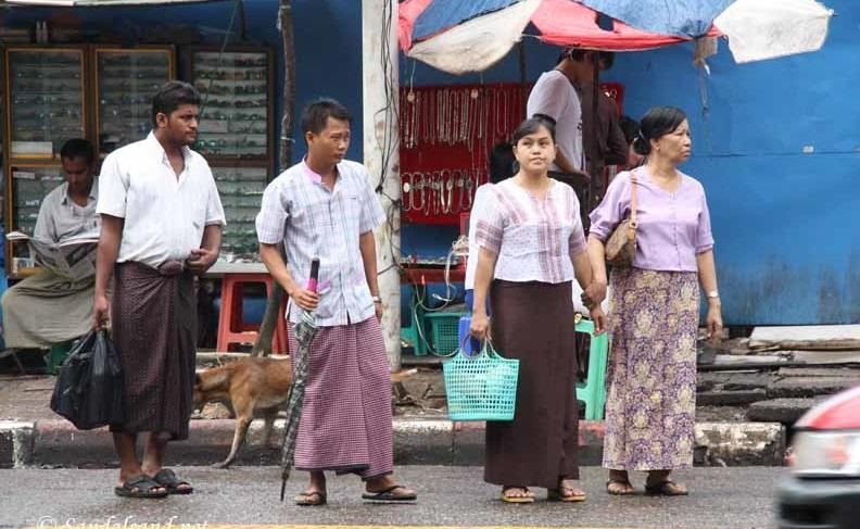Men and women are wearing Longyi and Htamein