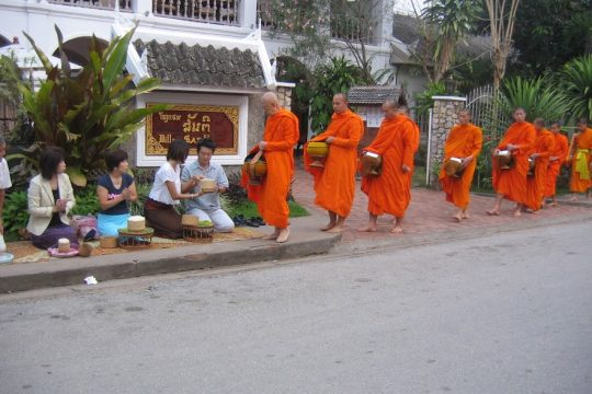 Alms Giving ceremony in Laos culture
