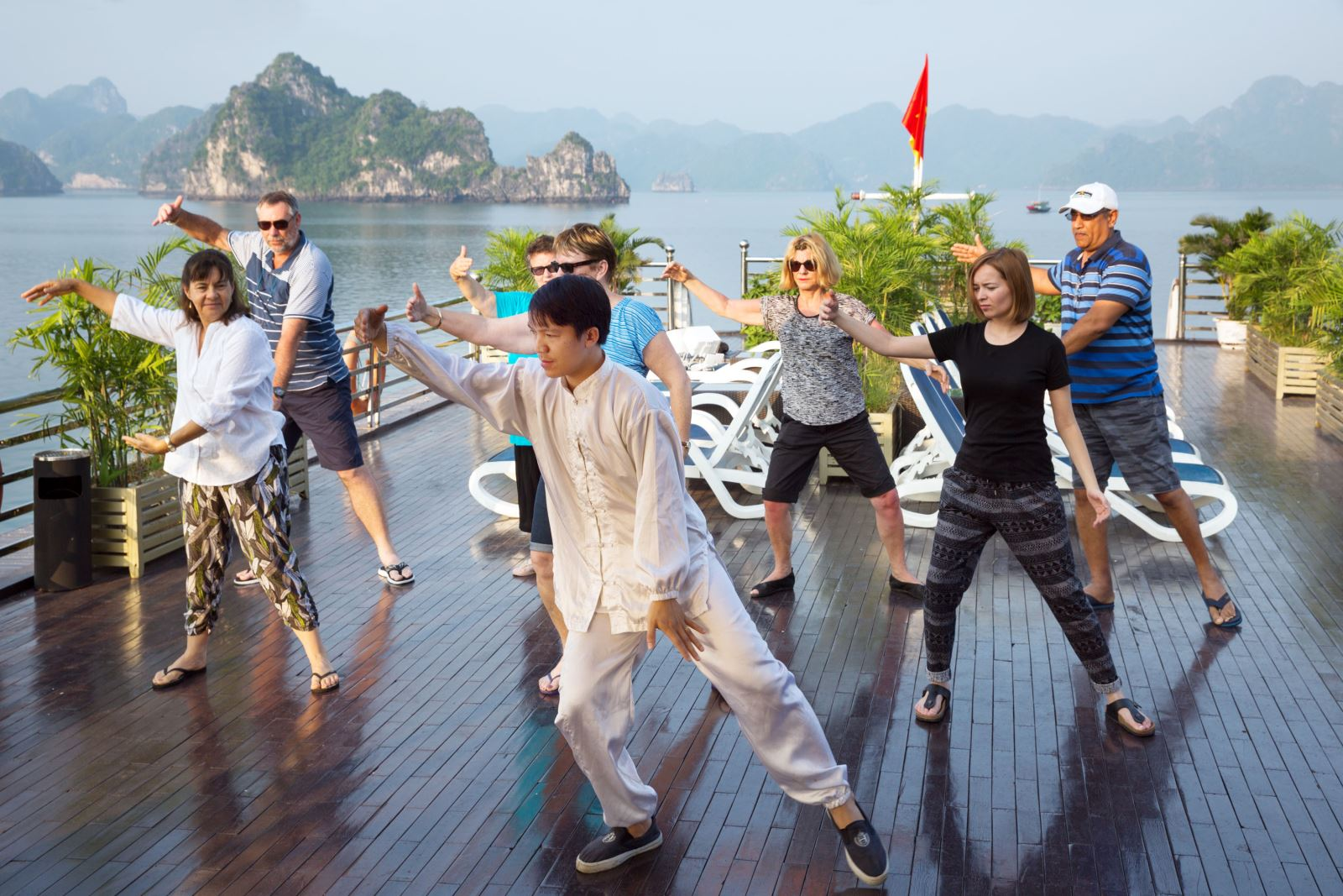 Practicing-Tai-Chi-by-the-sunrise-magnificent-Halong-Bay