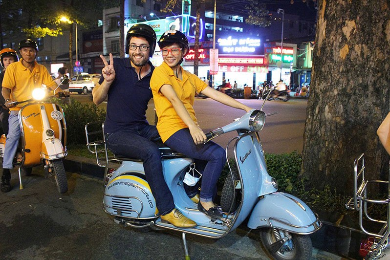 Being-on-the-back-of-Vespa-in-Saigon