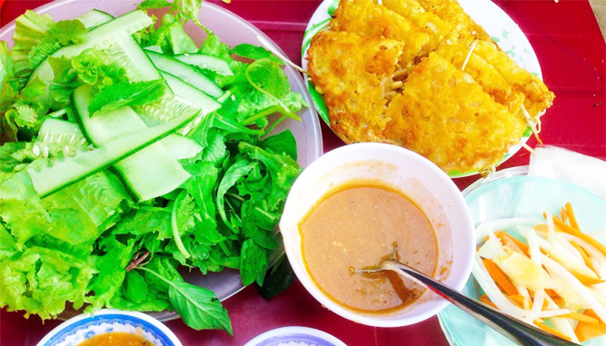 Banh Xeo with herbs and special sauce