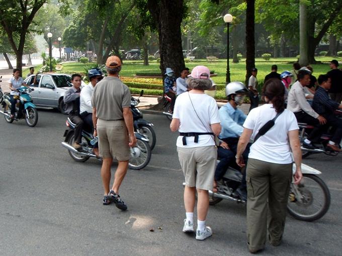 Encounter The Bewildering Traffic in Vietnam? Let just cross…