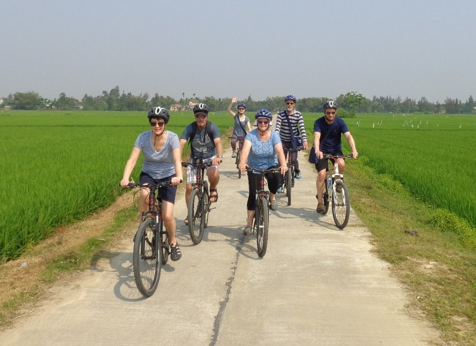 Tourists are excited about riding through rural areas in Hoi An