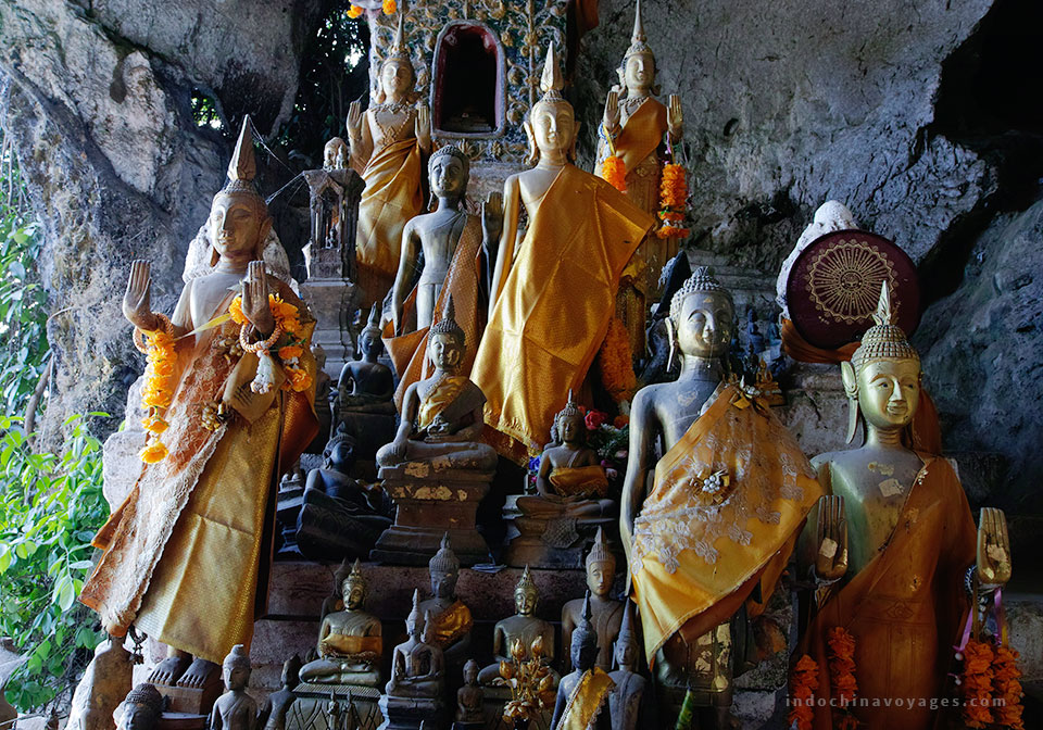 embark on a cruise up the Mekong River to Pak Ou Caves