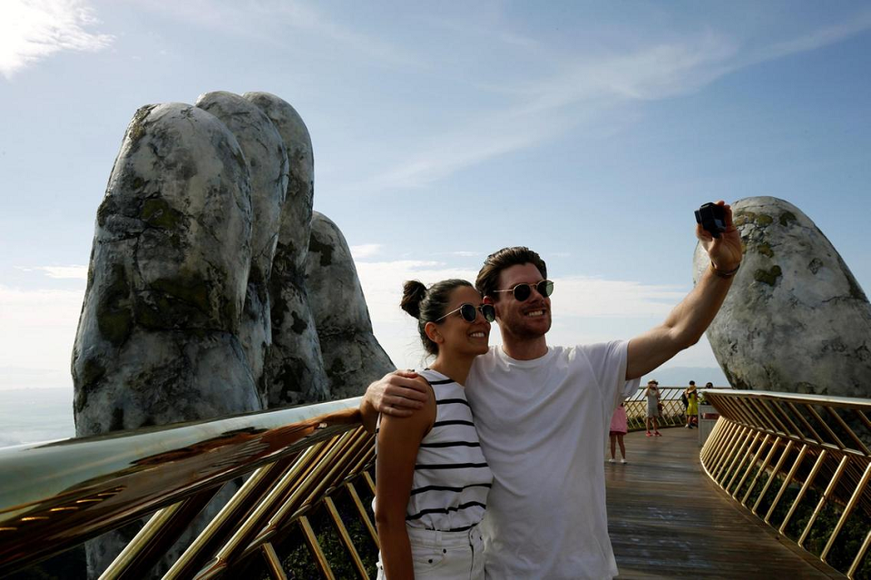 "Taking selfies on ""the border"" between paradise and the earth"