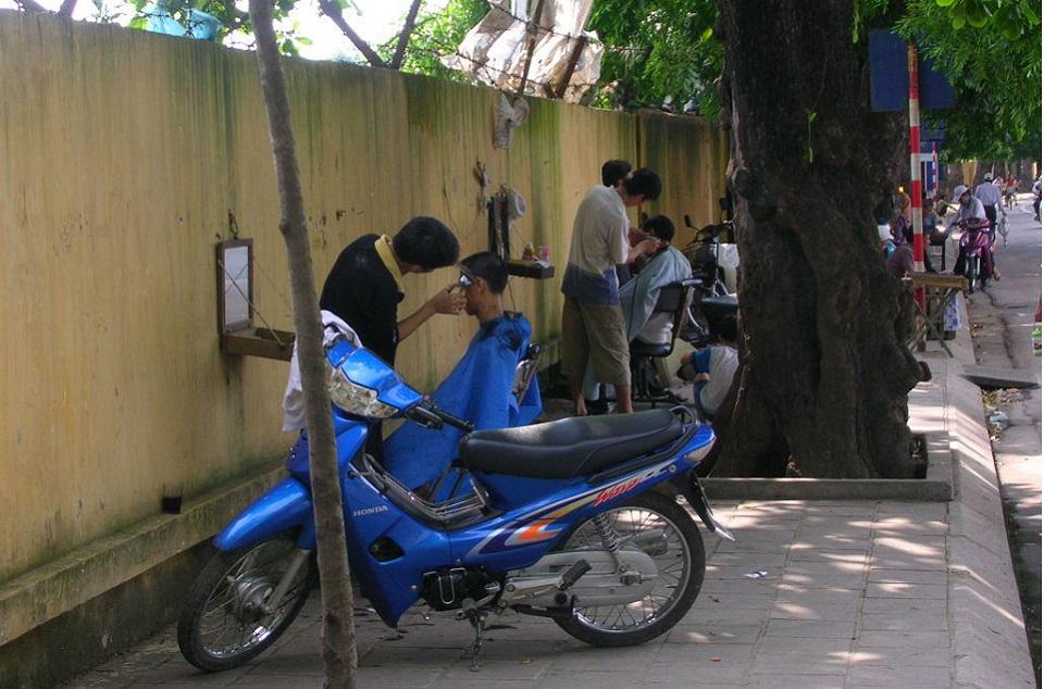 Roadside barbers in Hanoi