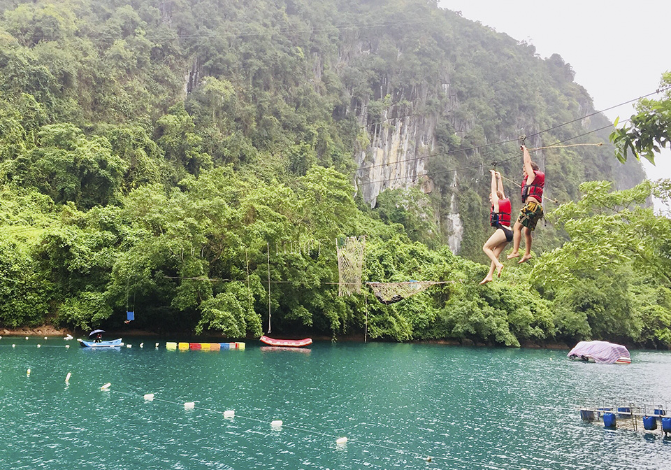 Having fun with zip line in Nuoc Mooc - Phong Nha Ke Bang National Park