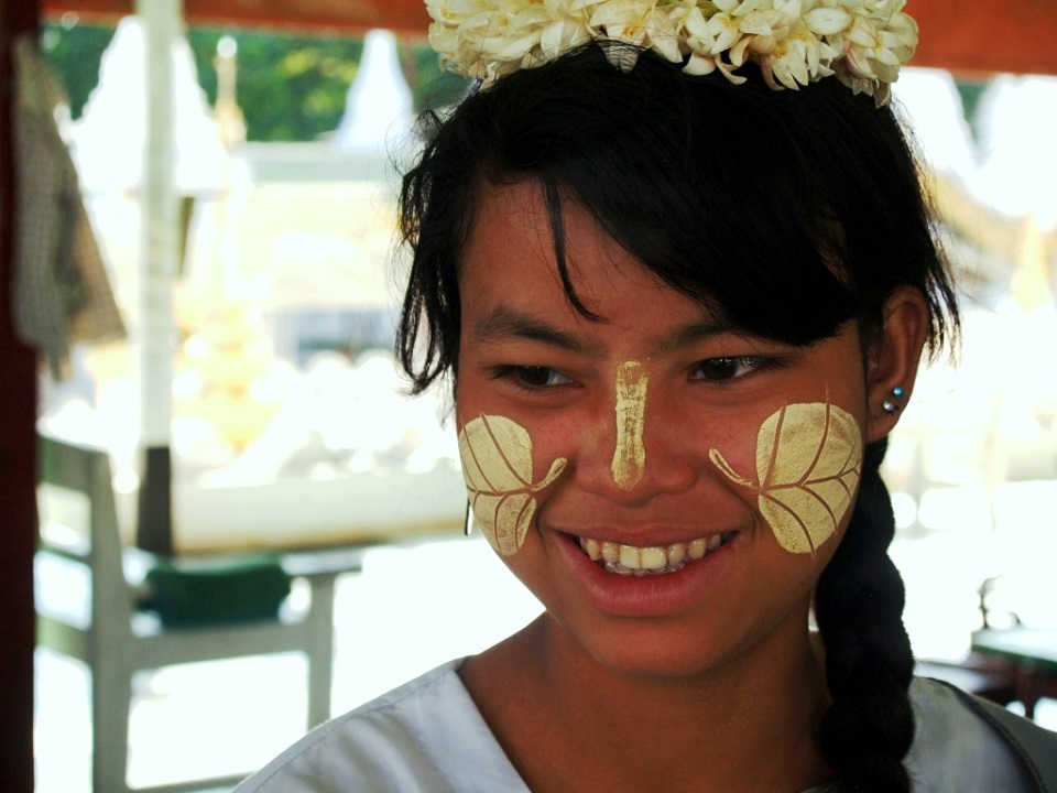 Myanmar girls with traditional Thanaka on their faces