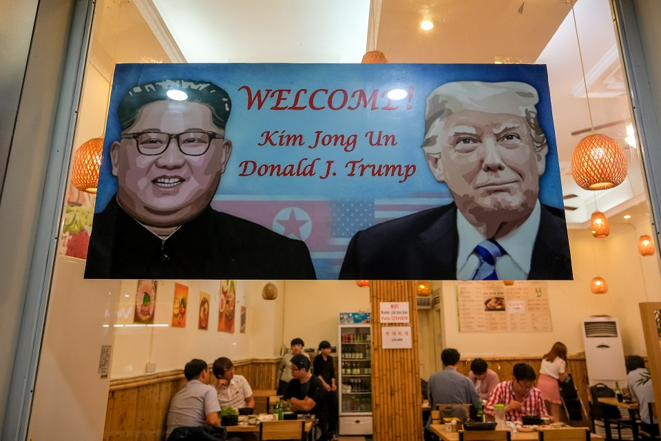 A Trump Kim welcoming sign