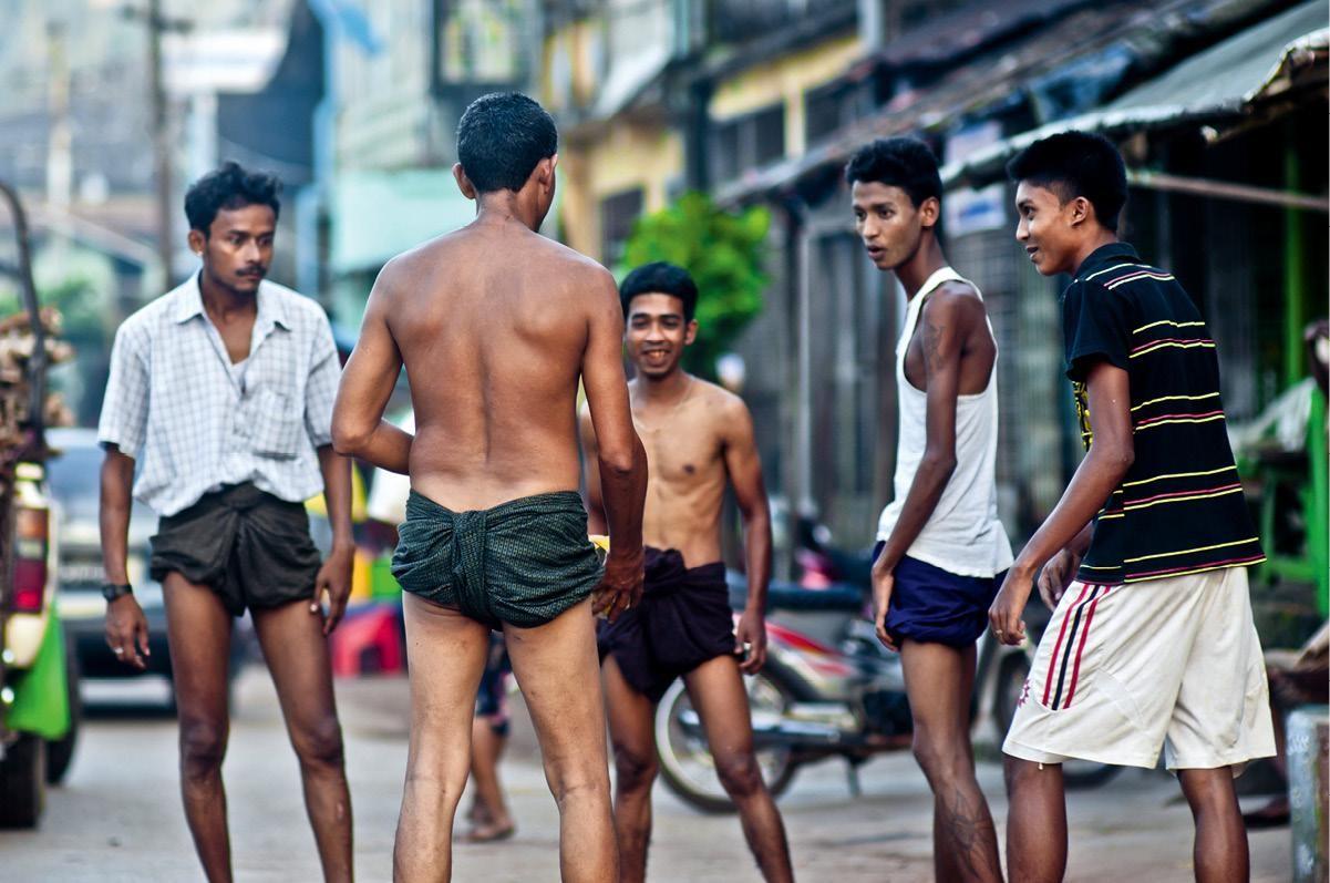 Burmese men playing kick volleyball